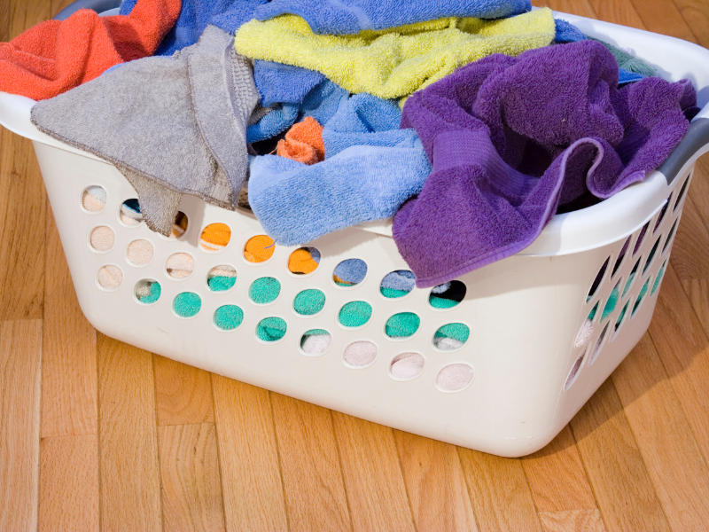 white laundry basket filled with towels